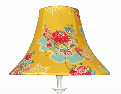 White table lamp base with vibrant yellow japanese print shade